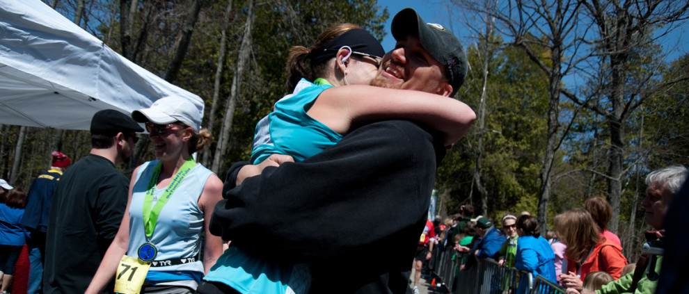 Finish-Line-Hug-Header-Dooor-County-Half-Marathon