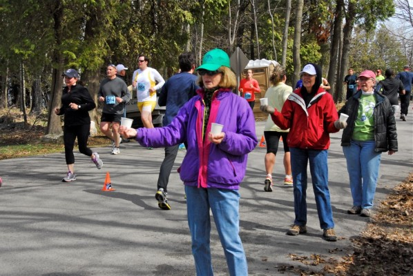 Friends of Peninsula State Park volunteers hand out water and gatorade in 2015.